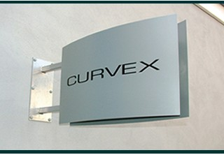 Curvex projecting sign