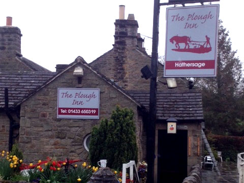Pub signs for The Plough at Hathersage